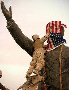 PICTURE BY PETER NICHOLLS THE TIMES-BAGHDAD 09/04/03 US SOLDIER PLACES STARS AND  STRIPES OVER STATUE OF SADDAM, PRIOR TO PULLING IT DOWN